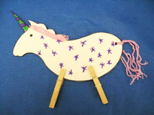 Unicorn paper craft with clothespins for legs