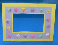 Paper frame decorated with candy hearts