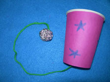 Decorated Cup with ball on string