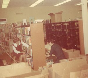 Library staff shelving books after renovation Dec. 1969
