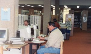 Two male patrons using internet computers c1997