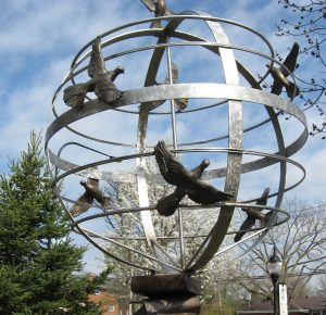 Peace Sculpture - doves flying around a sphere