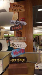 signs pointing to fantastical storybook lands