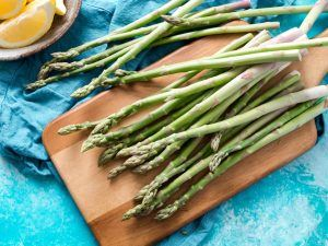asparagus on a wooden cutting board