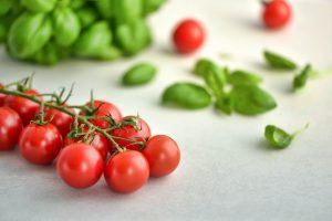 cherry tomatoes and basil leaves