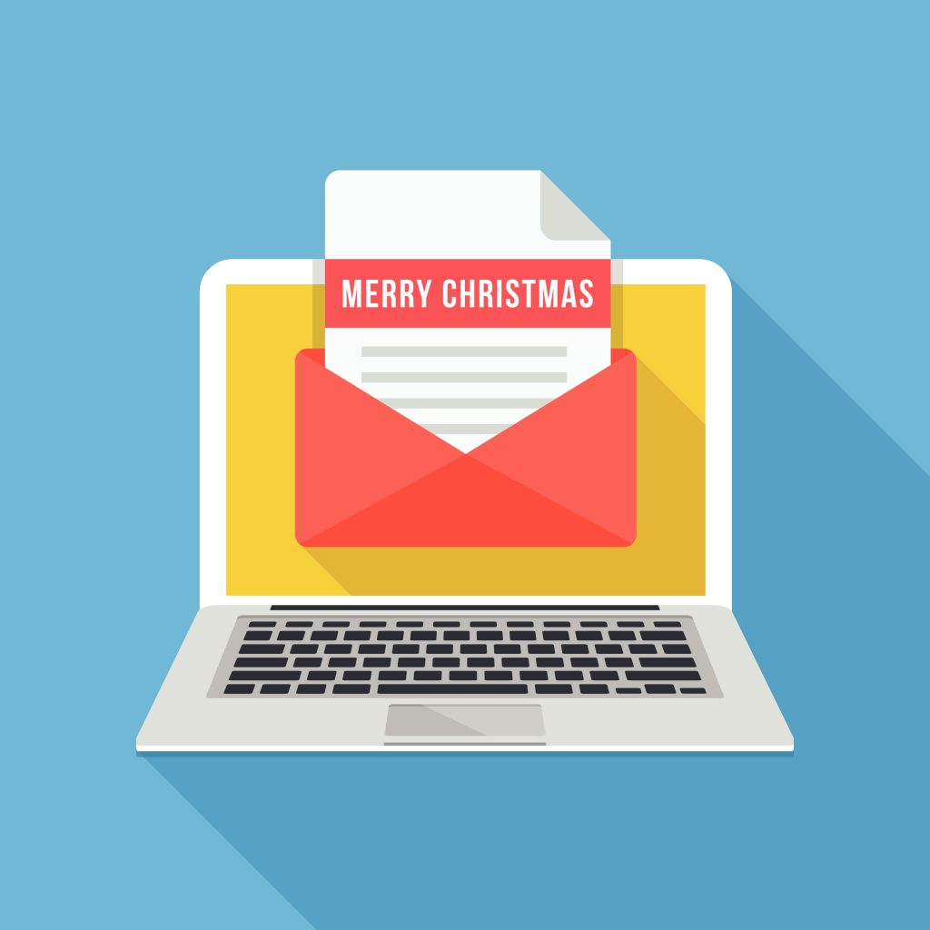 Merry Christmas letterin in email envelope on laptop