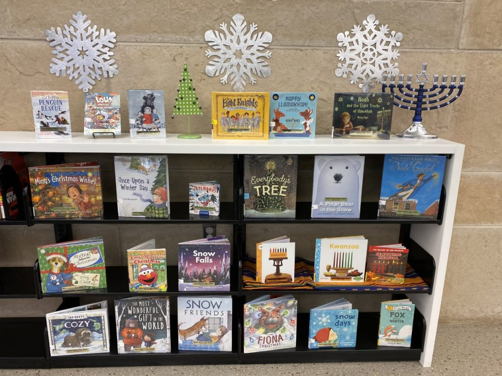 2020 winter holiday books for kids displayed on a shelf