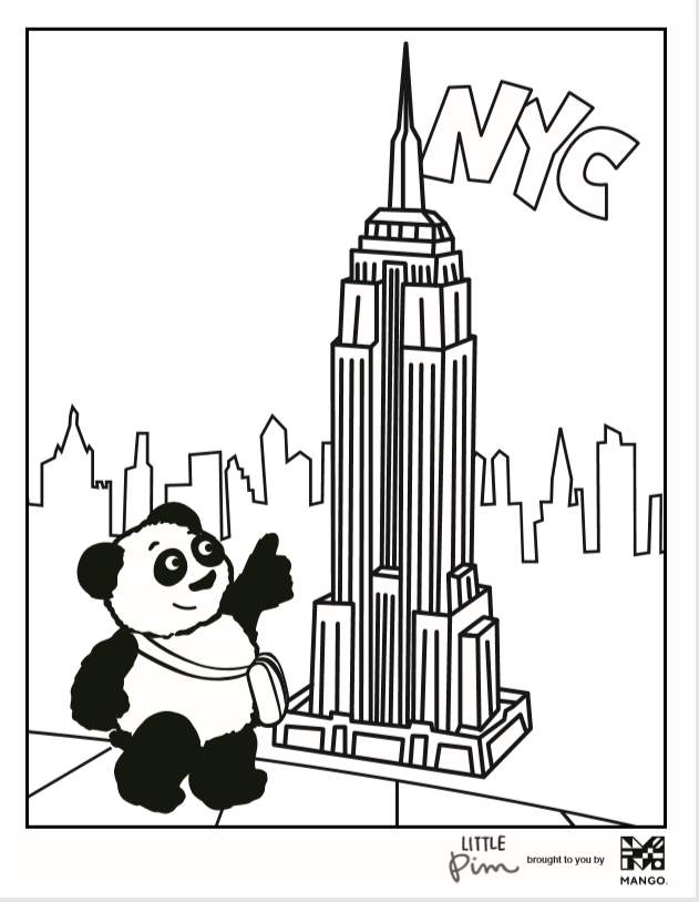 Little Pim in NYC pointing at Empire State building